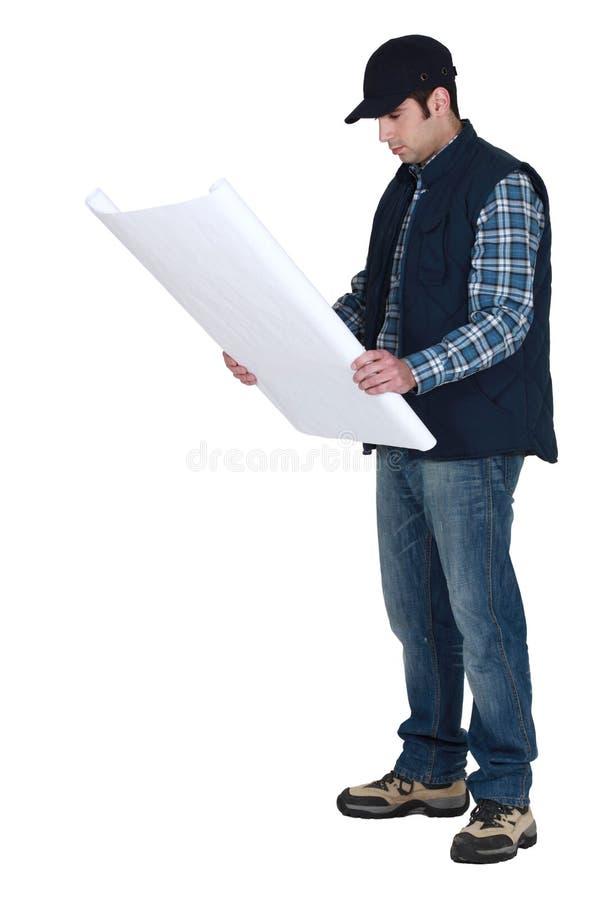 Handwerker, der unglücklich schaut stockbilder
