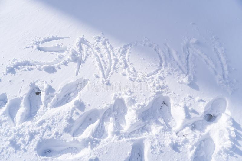 Handwriting Śnieżny tekst fotografia stock