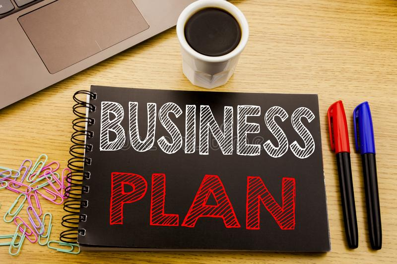 Handwriting Announcement text showing Business Plan Planning. Business concept for Preparation Project Strategy written on noteboo. K book on wooden background stock photography