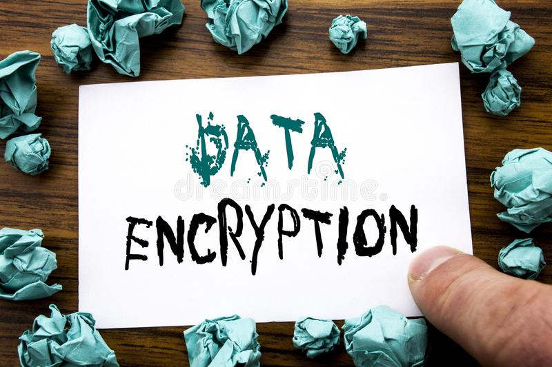 Handwriting Announcement text showing Data Encryption. Business concept for Information Security Written on sticky note paper, woo. Den background folded yellow stock photography