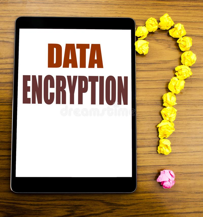 Handwriting Announcement text showing Data Encryption. Business concept for Information Security Written on tablet with wooden bac. Handwriting Announcement text stock image
