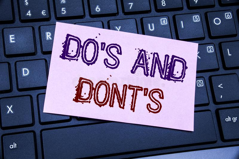 Handwriting Announcement text showing Do s And Do Not Donts. Business concept for Guide Allowed written on sticky note paper on th. Handwriting Announcement text stock photography