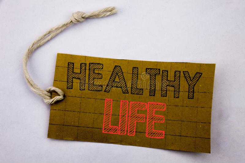 Handwriting Announcement text showing Healthy Life. Business concept for online sale Good Health Food written on price tag paper o royalty free stock image