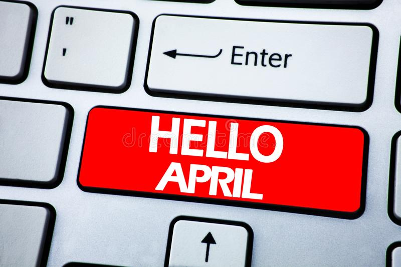 Handwriting Announcement text showing Hello April. Business concept for Spring Welcome written on red key on the keybord backgroun stock photos