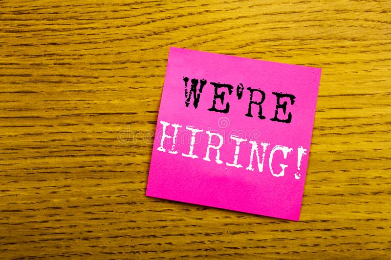Handwriting Announcement text showing We Are Hiring Now. Business concept for Recruitment Human Resources written on sticky note stock photo