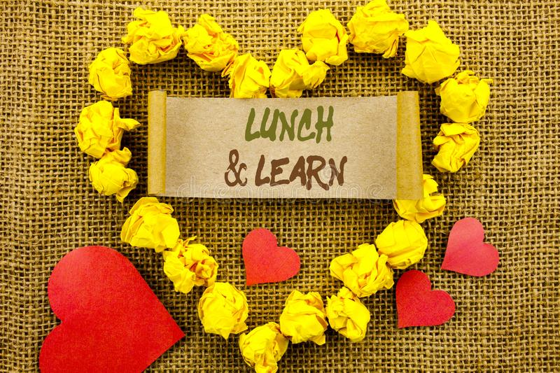 Handwriting Announcement text showing Lunch And Learn. Concept meaning Presentation Training Board Course written on Sticky Note P. Handwriting Announcement text stock image
