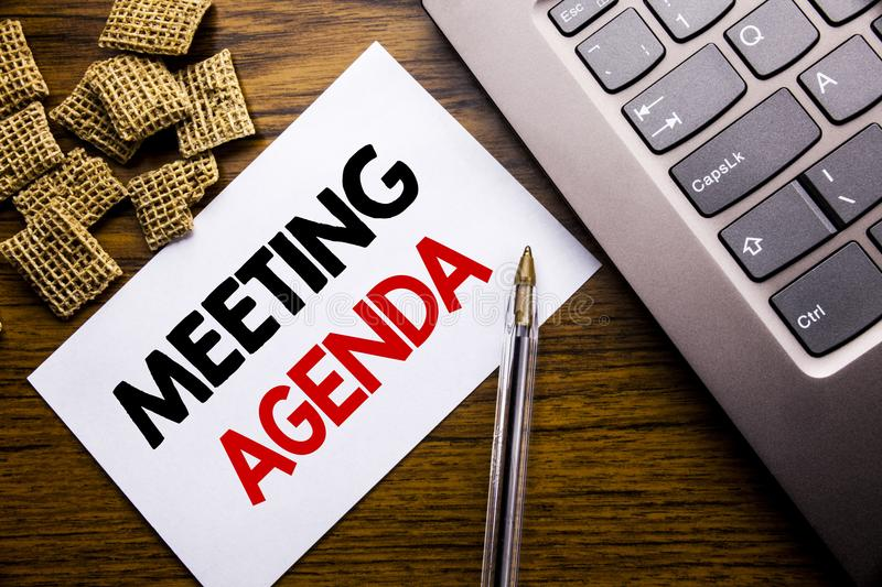 Handwriting Announcement text showing Meeting Agenda. Business concept for Business Schedule Plan written on sticky note paper on. Wooden background next to the stock photography