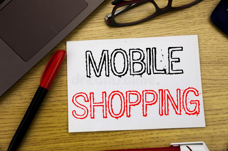 Handwriting Announcement text showing Mobile Shopping. Business concept for Cellphone online order written on paper, wooden backgr. Ound in office copy space stock photography
