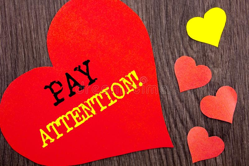 Handwriting Announcement text showing Pay Attention. Concept meaning Be Careful Beware Mindful Alarm written on Heart Love on the. Handwriting Announcement text royalty free stock photos