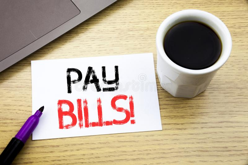 Handwriting Announcement text showing Pay Bills. Business concept for Finance Paying Online written on notebook book on the wooden. Handwriting Announcement text royalty free stock images