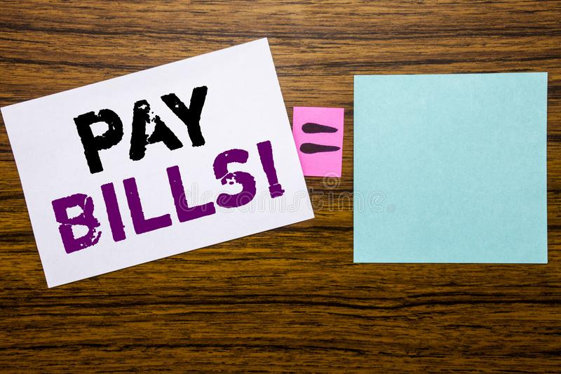 Handwriting Announcement text showing Pay Bills. Business concept for Finance Paying Online written on sticky note paper on wooden. Handwriting Announcement text stock image