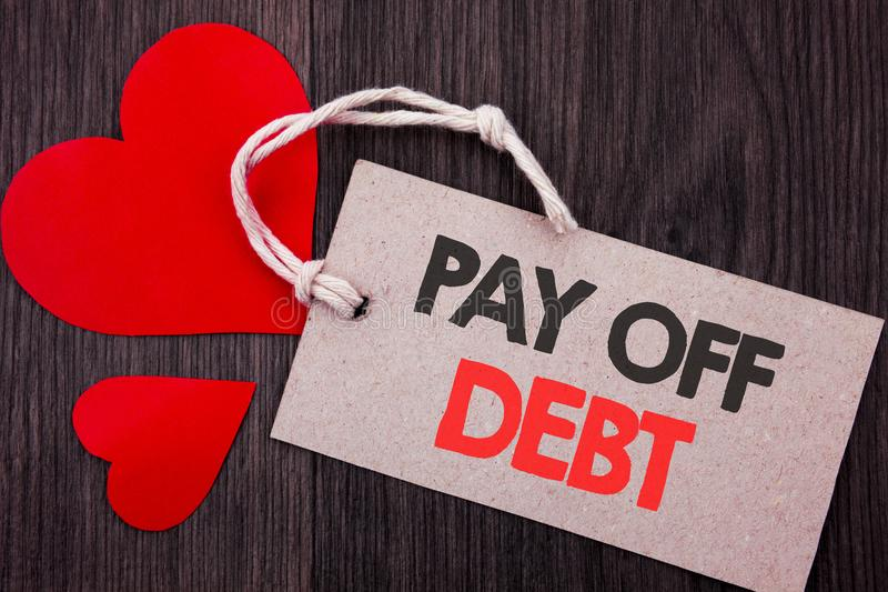 Handwriting Announcement text showing Pay Off Debt. Business concept for Reminder To Paying Owed Financial Credit Loan Bills writt. En on Price tag with Red stock image