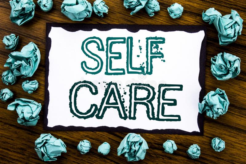 Handwriting Announcement text showing Self Care. Business concept for Taking caring for own Health Written on sticky note paper, w. Ooden background folded blue royalty free stock photos