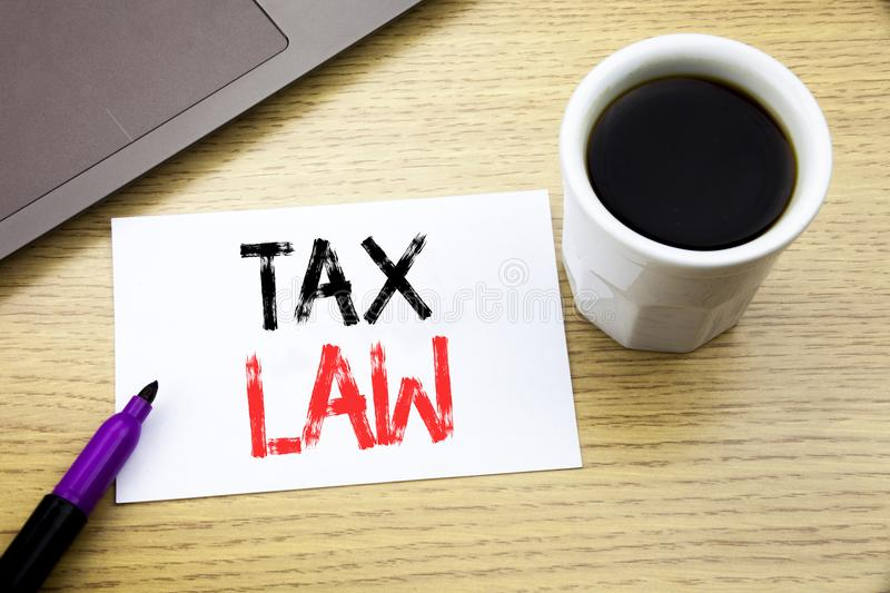 Handwriting Announcement text showing Tax Law. Business concept for Taxation Taxes Rule written on notebook book on the wooden bac stock photo