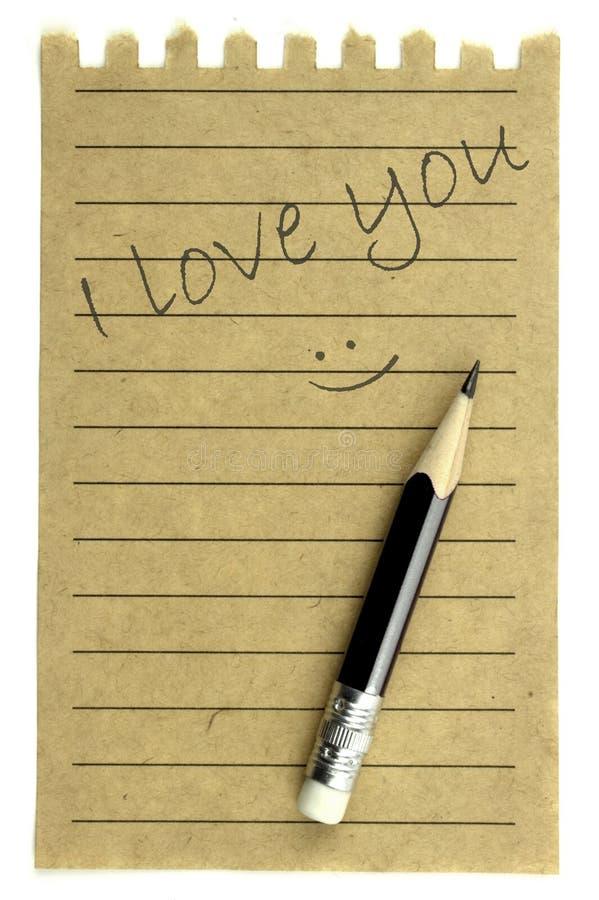 Handwriting kocham ciebie na naturalnym nutowym papierze fotografia stock