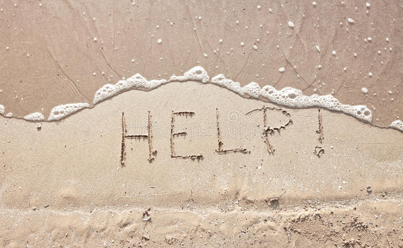 Handwriting message word help at sea beach sand. Handwriting message help at sea beach sand stock image