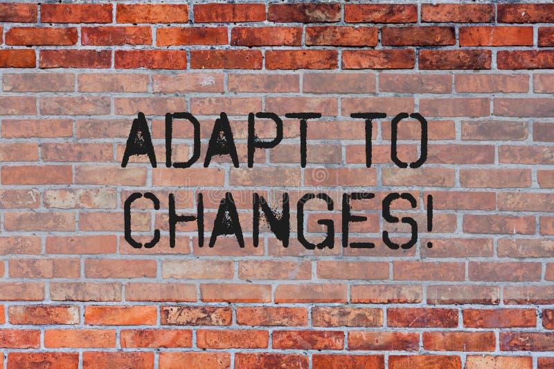 Handwriting tekst Adaptuje zmiany Pojęcie znaczy Nowatorską zmiany adaptację z technologiczną ewolucji ścianą z cegieł royalty ilustracja