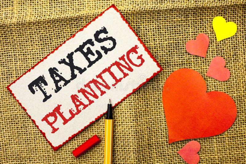 Handwriting teksta podatków planowanie Pojęcie znaczy Pieniężnego Planification Podatkowe Biznesowe zapłaty Przygotowywał pisze n obraz stock