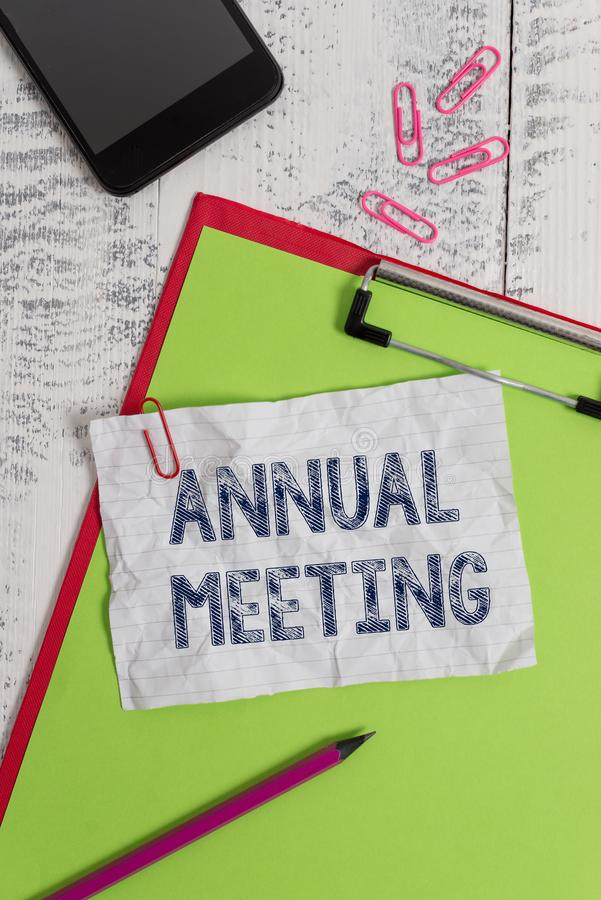 Handwriting text Annual Meeting. Concept meaning Yearly gathering of an organization interested shareholders Clipboard royalty free stock images