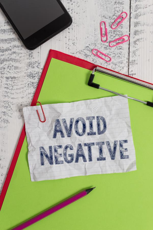 Handwriting text Avoid Negative. Concept meaning Staying away from pessimistic showing Suspicious Depression Clipboard. Handwriting text Avoid Negative royalty free stock photography