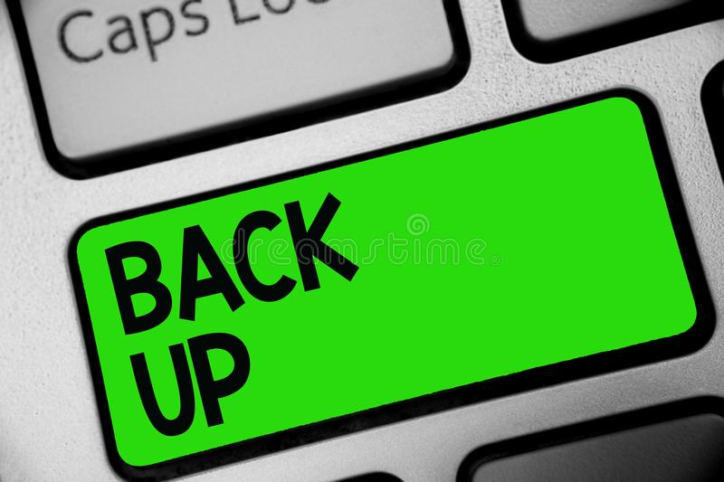 Handwriting text Back Up. Concept meaning saving important data into internet cloud and restore them later Keyboard green key Inte royalty free stock images