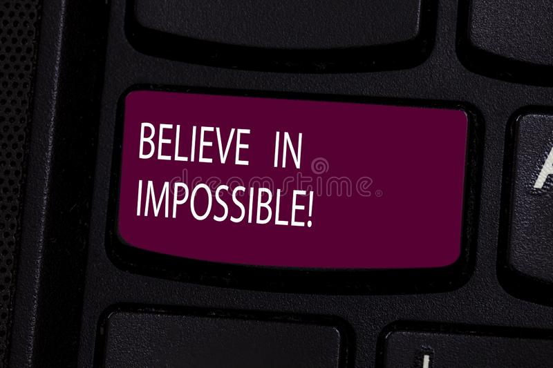 Handwriting text Believe In Impossible. Concept meaning Never give up hope that something amazing will happen Keyboard royalty free stock photography