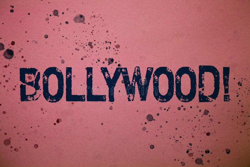Handwriting text Bollywood Motivational Call. Concept meaning Hollywood Movie Film Entertainment Cinema Ideas messages pink backgr. Ound splatters messy paint royalty free stock photo