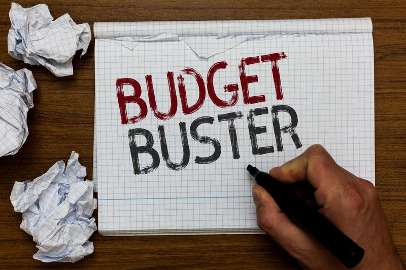 Handwriting text Budget Buster. Concept meaning Carefree Spending Bargains Unnecessary Purchases Overspending Man holding marker n stock photo