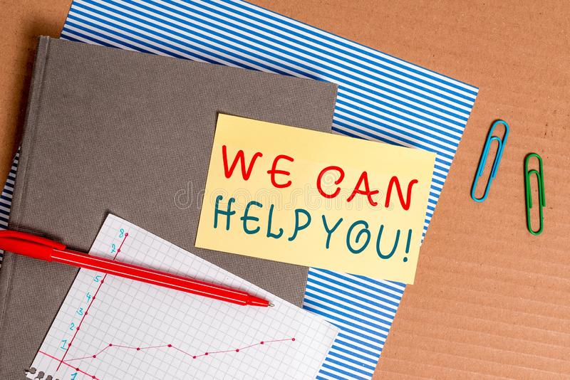 Handwriting text We Can Help You. Concept meaning offering good assistance to customers or friends Striped paperboard. Handwriting text We Can Help You stock photography