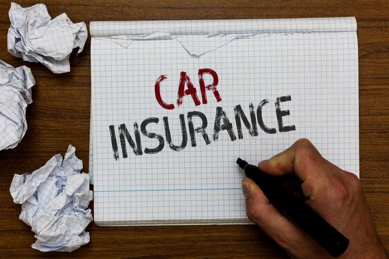 Handwriting text Car Insurance. Concept meaning Accidents coverage Comprehensive Policy Motor Vehicle Guaranty Man holding marker. Notebook crumpled papers stock images