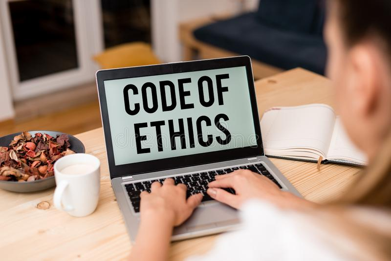 Handwriting text Code Of Ethics. Concept meaning basic guide for professional conduct and imposes duties woman laptop. Handwriting text Code Of Ethics royalty free stock images