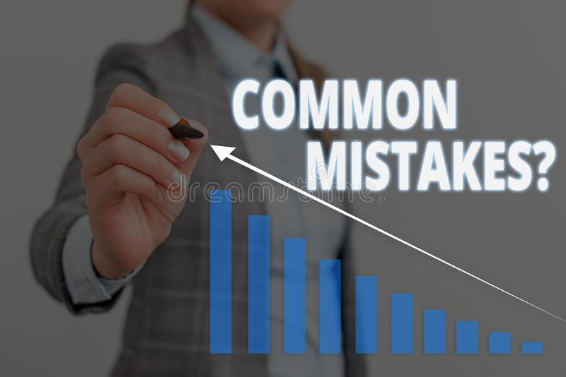 Handwriting text Common Mistakes question. Concept meaning repeat act or judgement misguided or wrong Woman wear formal. Handwriting text Common Mistakes royalty free stock images