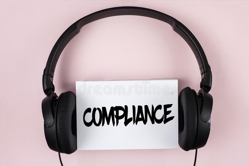 Handwriting text Compliance. Concept meaning Technology Company sets its policy standard regulations written on White Sticky Note royalty free stock photography