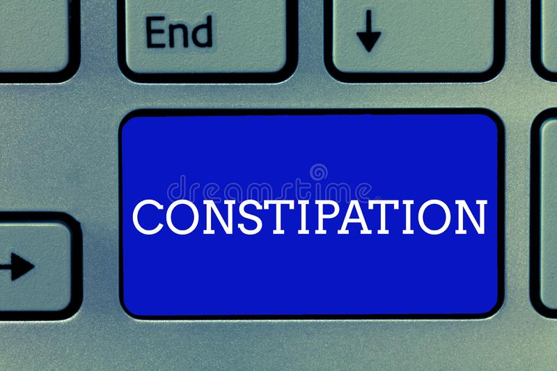 Handwriting text Constipation. Concept meaning Bowel movements that are erratic Trouble in clearing the bowels.  stock images