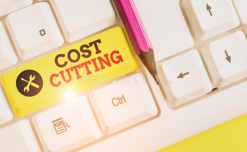 Handwriting text Cost Cutting. Concept meaning actions taken to reduce the amount that is spent on a service White pc. Handwriting text Cost Cutting. Conceptual stock images