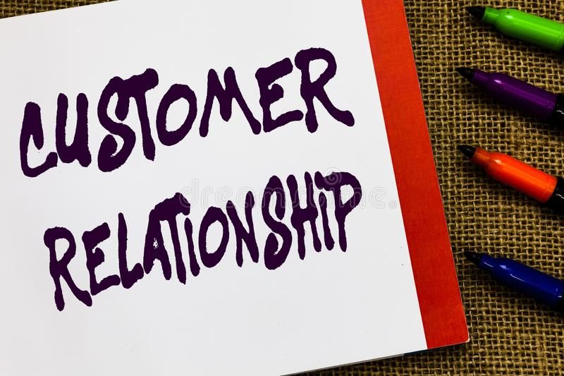 Handwriting text Customer Relationship. Concept meaning Deal and Interaction between Company and Consumers Open notebook. Page jute background colorful markers royalty free stock images