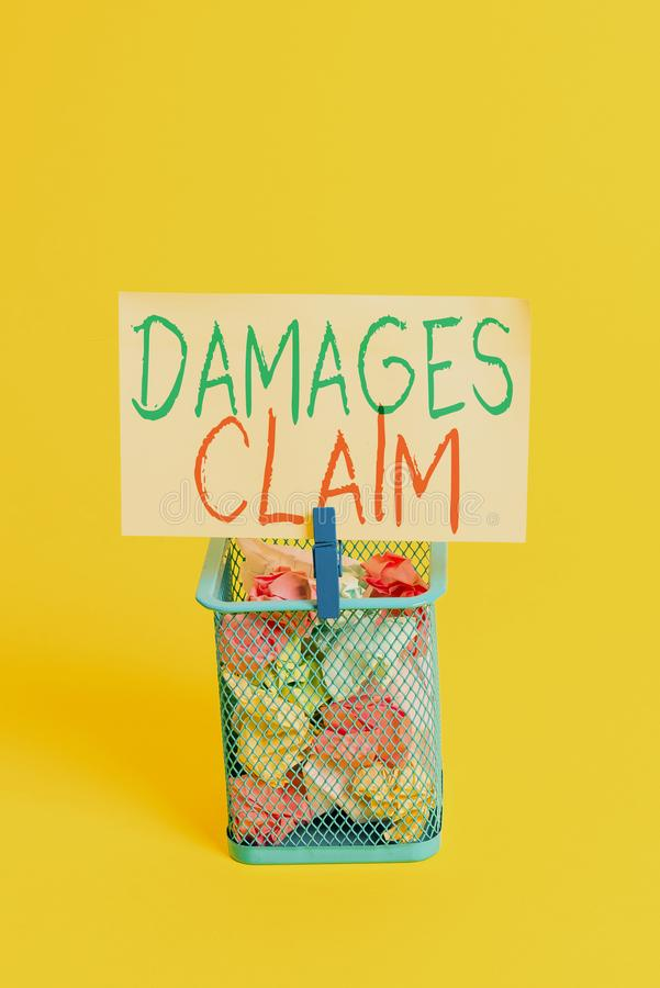 Handwriting text Damages Claim. Concept meaning Deanalysisd Compensation Litigate Insurance File Suit Trash bin crumpled paper. Handwriting text Damages Claim royalty free stock image