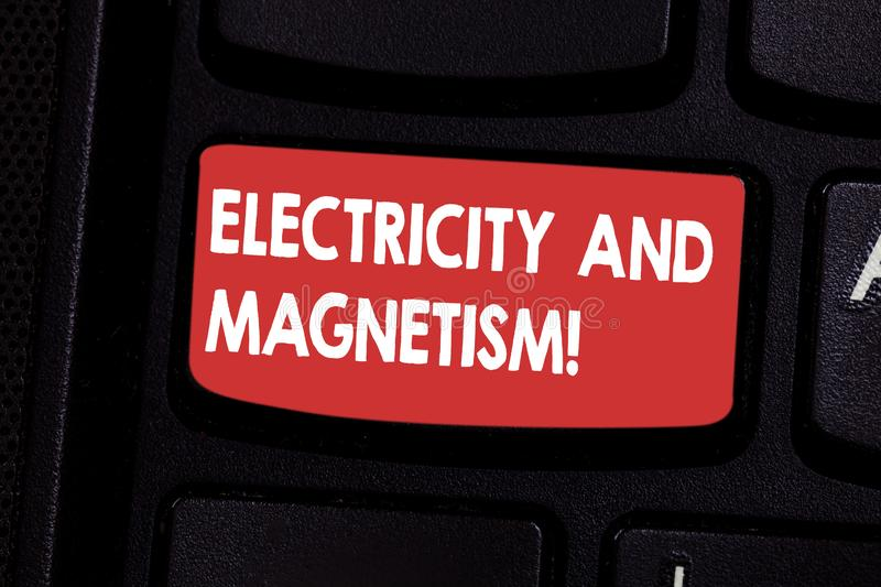 Handwriting text Electricity And Magnetism. Concept meaning Embodies a single core electromagnetic force Keyboard key stock photos