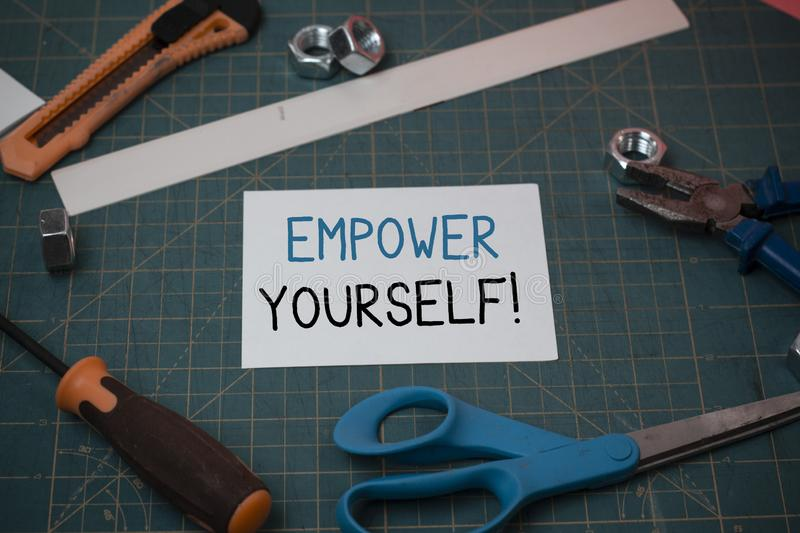 Handwriting text Empower Yourself. Concept meaning taking control of our life setting goals and making choices Carpentry. Handwriting text Empower Yourself royalty free stock images