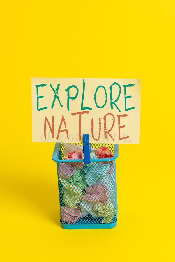 Handwriting text Explore Nature. Concept meaning Reserve Campsite Conservation Expedition Safari park Trash bin crumpled. Handwriting text Explore Nature stock image