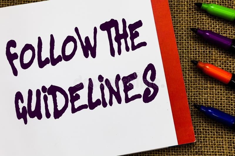 Handwriting text Follow The Guidelines. Concept meaning Manual of Style Follow a Specified Rule Accordingly Open. Notebook page jute background colorful markers stock images