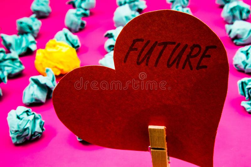 Handwriting text Future. Concept meaning Period of time following the present moment Events that will happen Clothespin holding re. D heart paper crumpled papers stock photos