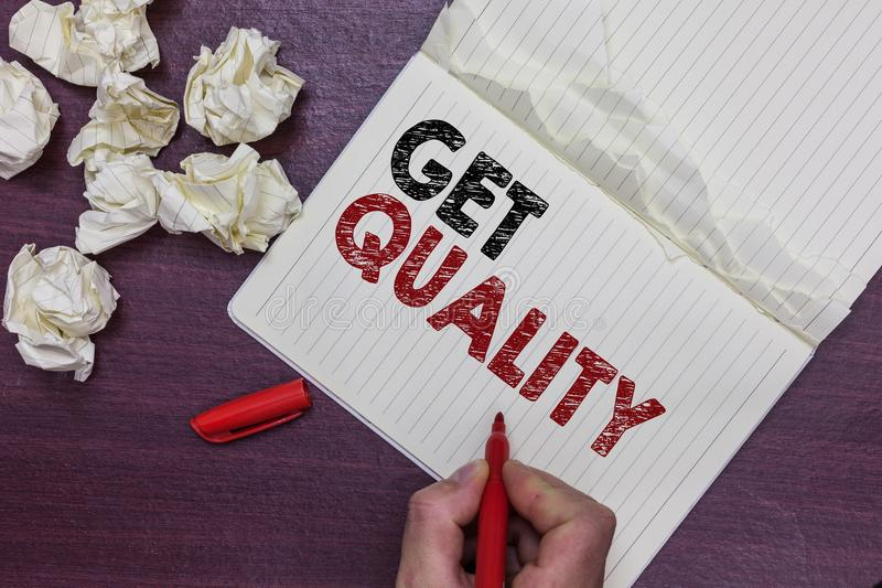 Handwriting text Get Quality. Concept meaning features and characteristics of product that satisfy needs Man holding marker notebo royalty free stock photos