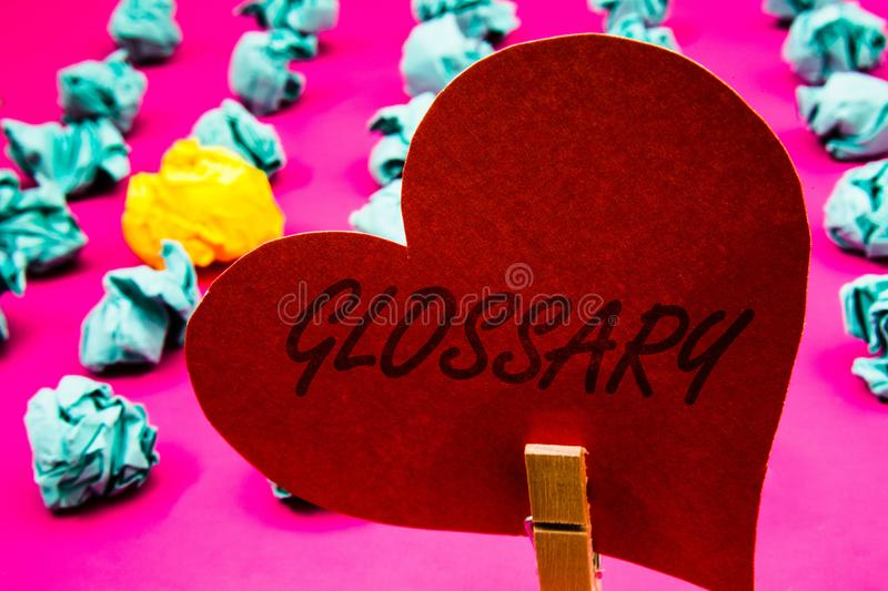 Handwriting text Glossary. Concept meaning Alphabetical list of terms with meanings Vocabulary Descriptions Clothespin holding red. Heart paper crumpled papers royalty free stock image