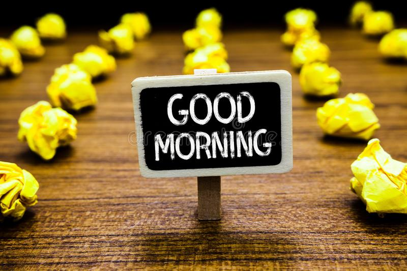 Handwriting text Good Morning. Concept meaning A conventional expression at meeting or parting in the morning Blackboard crumpled. Papers several tries mistake royalty free stock photos