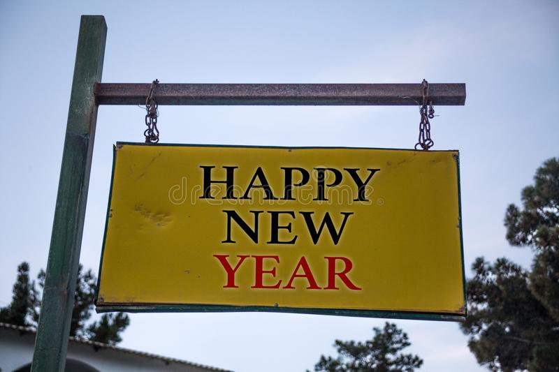 Handwriting text Happy New Year. Concept meaning congratulations Merry Xmas everyone beginning of January Messages object location. Yellow banner frame metal stock image