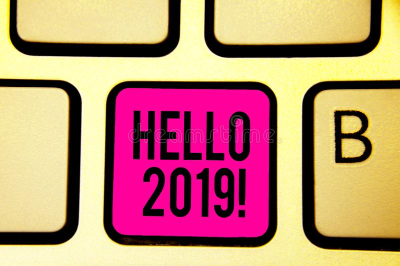 Handwriting text Hello 2019. Concept meaning expression or gesture of greeting answering the telephone Keyboard pink key Intention stock photos