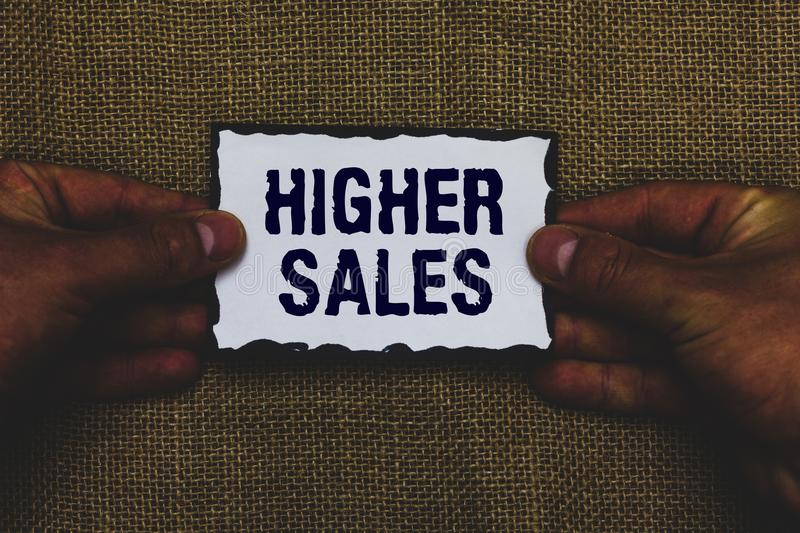 Handwriting text Higher Sales. Concept meaning The average sold products and services of a company has grown Man holding piece pap. Er black borders jute stock photos