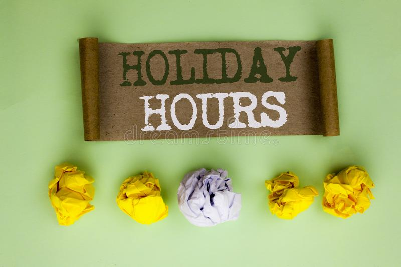Handwriting text Holiday Hours. Concept meaning Celebration Time Seasonal Midnight Sales Extra-Time Opening written on Cardboard P. Handwriting text Holiday royalty free stock photos