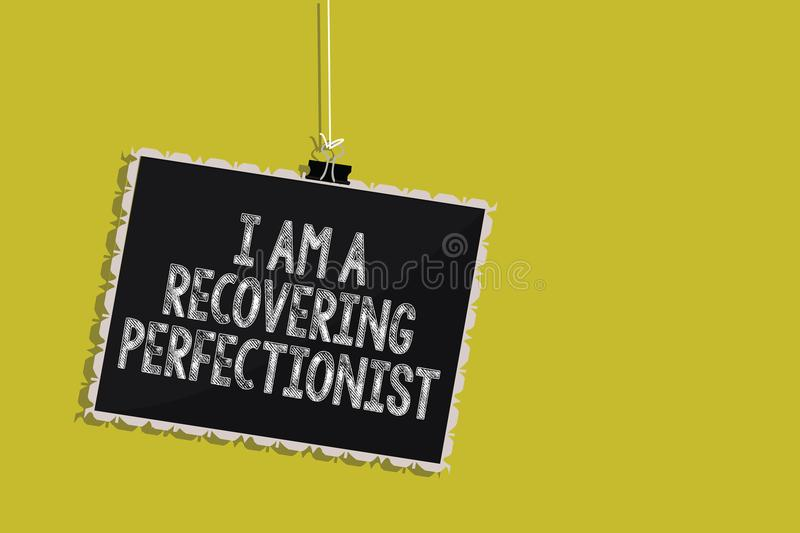 Handwriting text I Am A Recovering Perfectionist. Concept meaning Obsessive compulsive disorder recovery Hanging blackboard messag. E communication information stock illustration